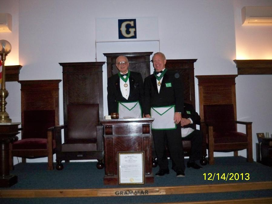 DAVID E. LEWIS, SM PRESENTING R. BRADLEY ALDERFER WITH HIS PAST SOVEREIGN MASTER JEWEL AND COLLAR.